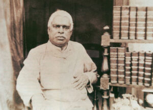 Srila-Bhaktivinoda-Thakura-Beside-Books