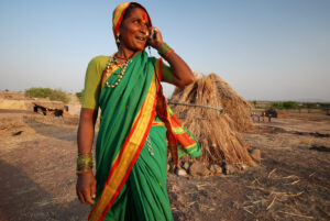 Indian woman on mobile in field